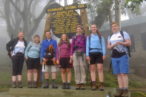 The start of our trek at Machame Gate. In the clouds. Cam the Lion (our mascot) is on Andy's rucksack.